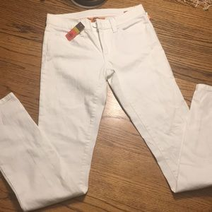 Tory Burch stonewashed white jeans